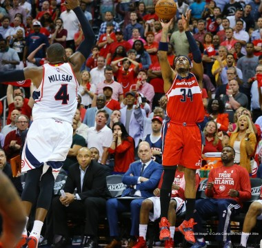 May 13, 2015 - Atlanta, GA, USA - The Washington Wizards' Paul Pierce (34) hits a 3-pointer over the Atlanta Hawks' Paul Millsap to take an 81-80 lead over the Hawks with 8.3 seconds left on the game clock in Game 5 of the Eastern Conference semifinals on Wednesday, May 13, 2015, at Philips Arena in Atlanta. The Hawks won, 82-81, for a 3-2 series lead. (Credit Image: � Curtis Compton/TNS/ZUMA Wire)