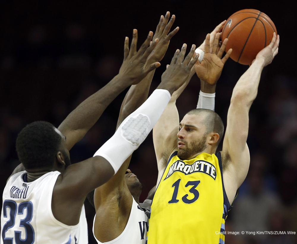 Feb. 4, 2015 - Philadelphia, PA, USA - Villanova's Daniel Ochefu (23) and Dylan Ennis double-team Marquette's Matt Carlino (13) in the second half at the Wells Fargo Center in Philadelphia on Wednesday, Feb. 4, 2015. Villanova won, 70-52. (Credit Image: � Yong Kim/TNS/ZUMA Wire)
