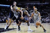 March 12, 2015 - San Antonio Spurs guard Tony Parker drives past the Cleveland Cavaliers' LeBron James as Tim Duncan and Timofey Mozgov track the play in the first half of an NBA basketball game Thursday, March 12, 2015 in San Antonio, Texas. The Cavaliers beat the Spurs, 128-125 in overtime. (Credit Image: © Bahram Mark Sobhani/ZUMA Wire)