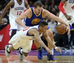 Feb. 9, 2015 - Philadelphia, PA, USA - Philadelphia 76ers' Tim Frazier dives under Golden State Warriors' David Lee for the ball during the fourth quarter on Monday, Feb. 9, 2015, at the Wells Fargo Center in Philadelphia. (Credit Image: � Steven M. Falk/TNS/ZUMA Wire)
