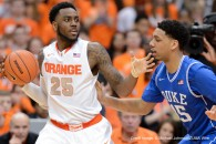 Feb. 14, 2015 - Syracuse, New York, U.S - Syracuse Orange forward RAKEEM CHRISTMAS (25) works the ball in the post as Duke Blue Devils center JAHLIL OKAFOR (15) defends in the second half at the Carrier Dome in Syracuse, NY. Duke defeated Syracuse 80-72 in front of 35,446. (Credit Image: © Michael Johnson/ZUMA Wire)