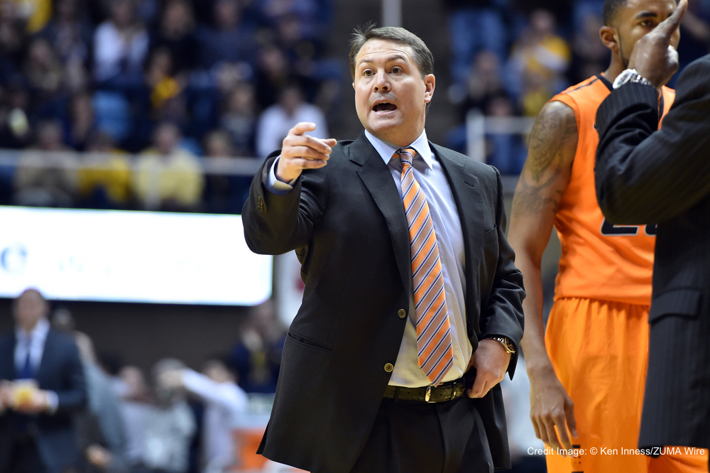 March 7, 2015 - Morgantown, WV, US - Oklahoma State Cowboys head coach TRAVIS FORD tries to get the attention of an official (not pictured) during the basketball game between the Oklahoma State Cowboys and West Virginia Mountaineers played at the Coliseum in Morgantown, WV. (Credit Image: © Ken Inness/ZUMA Wire)