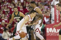 January 17, 2016: Wisconsin Badgers guard Bronson Koenig #24 dribbles off a screen during the NCAA Basketball game between the Michigan State Spartans and the Wisconsin Badgers at the Kohl Center in Madison, WI. Wisconsin defeated Michigan State 77-76. John Fisher/CSM(Credit Image: © John Fisher/CSM via ZUMA Wire)