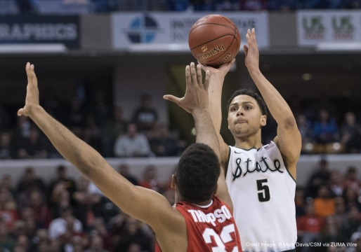 March 11, 2016 - Indianapolis, IN. U.S. - Michigan State Spartans guard Bryn Forbes #5 hits a shot over Ohio State Buckeyes center Trevor Thompson #32 in the first half during the quarterfinals of the Big Ten Conference mens basketball tournament between Michigan State and Ohio State at the Banker's Life Fieldhouse in Indianapolis, IN...Michigan State 81, Ohio State 54.Mark Davis/Cal Sport Media(Credit Image: © Mark Davis/CSM via ZUMA Wire)