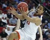 March 19, 2016 - Raleigh, NC, USA - Virginia's Malcolm Brogdon (15) pulls in a rebound in front of Butler's Austin Etherington (0) during the first half in the second round of the NCAA Tournament at PNC Arena in Raleigh, N.C., on Saturday, March 19, 2016. (Credit Image: � Ethan Hyman/TNS via ZUMA Wire)