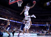 March 19, 2016 - Des Moines, IA, USA - Kansas guard Wayne Selden converts an alley-oop pass from teammate Devonte' Graham in the second half against Connecticut in the second round of the NCAA Tournament at Wells Fargo Arena in Des Moines, Iowa, on Saturday, March 19, 2016. Kansas advanced, 73-61. (Credit Image: � Rich Sugg/TNS via ZUMA Wire)