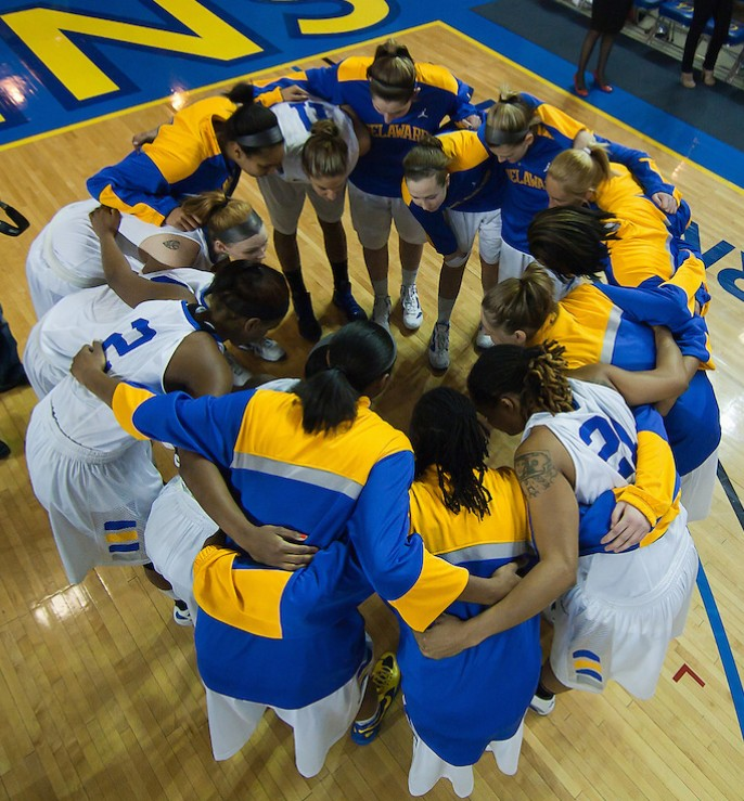 Photojournalist Suchat Person (Left) on assignment photographing The University of Delaware Women's Basketball team in the huddle on his day off prior to a NCAA college basketball game against Northeastern Sunday, Feb. 26, 2012 at the Bob Carpenter Center in Newark, Del.