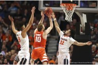 March 27, 2016 - Chicago, IL, USA - Virginia Cavaliers forward Anthony Gill (13) and Virginia Cavaliers guard London Perrantes (32) double team Syracuse Orange guard Trevor Cooney (10) during the first half on Sunday, March 27, 2016, at the United Center in Chicago. (Credit Image: � Nuccio Dinuzzo/TNS via ZUMA Wire)