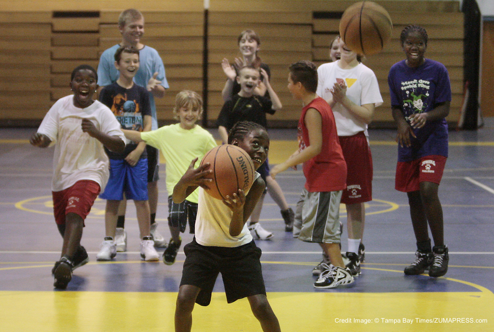 June 12, 2012 - FL, USA - WILL VRAGOVIC   |   Times.ht_355545_vrag_basketball_01 of 4 (6/12/12 Brooksville) Sy Crowley, 8, gets cheered on by fellow campers after draining the winning shot in a game of ''Knock Out,'' a shooting drill game, during the Hernando County Parks and Recreation Summer Basketball Camp held at West Hernando Middle School Tuesday morning. Conducted by the father and son team of Marion and Michael Jones, (Marion played college ball at St. Leo, Michael played at PHCC and is currently the assistant coach of the men's team at PHCC) the camp for 8 to 14 year-olds teaches rules, fundamentals, and introductory conditioning. On the second day of camp, Michael Jones said, ''It's going well, the kids are having fun. The best thing is they're doing something positive and keeping out of trouble.'' The camp is also being offered at West Hernando June 18-21 and July 16-19 and at Challenger K-8 July 9-12 from 9 a.m. till 3 p.m., the cost is 5, limit 50 campers. For more information, contact Hernando County Parks and Recreation at (352) 754-4031. [WILL VRAGOVIC, Times] (Credit Image: © Tampa Bay Times/ZUMAPRESS.com)