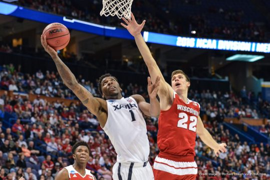 March 20, 2016 - St. Louis, Missouri, U.S - Xavier Musketeers forward JALEN REYNOLDS (1) gets inside Wisconsin Badger forward ETHAN HAPP (22) for a reverse layup shot during the second round of the Midwest Region in the 2016 NCAA Men's Basketball Tournament, where #10 Wisconsin upsets #2 Xavier by the score of 63-60 to advance to the sweet 16., held at The Scottrade Center in St. Louis, MO (Credit Image: © Richard Ulreich via ZUMA Wire)