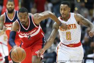 March 21, 2016 - Atlanta, GA, USA - Washington Wizards guard John Wall steals from Atlanta Hawks guard Jeff Teague on Monday, March 21, 2016, in Atlanta. The Wizards beat the Hawks 117-102. (Credit Image: � Curtis Compton/TNS via ZUMA Wire)