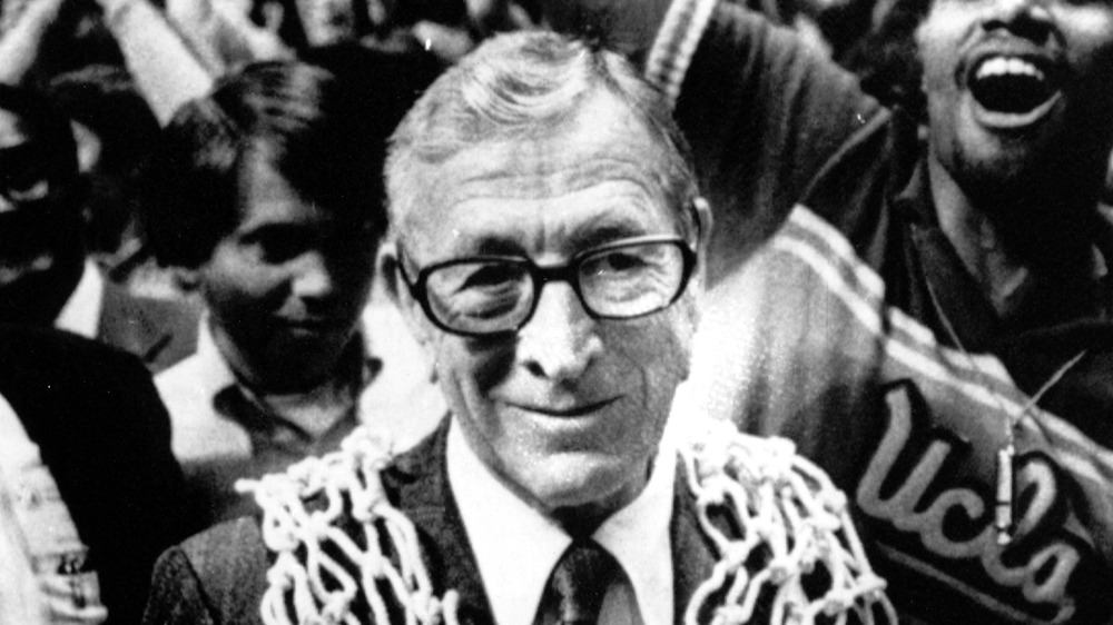 FILE -In this March 31, 1975, file photo, UCLA basketball coach John Wooden wears a basketball net around his neck after his team won the NCAA basketball championship over Kentucky, 92-85, in San Diego, Calif. The win gave him his 10th NCAA championship. Wooden, college basketball's gentlemanly Wizard of Westwood who built one of the greatest dynasties in all of sports at UCLA and became one of the most revered coaches ever, has died. He was 99. (AP Photo, File)