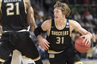 March 17, 2016 - U.S - Wichita State guard, RON BAKER (31), uses a screen to get past an Arizona defender in the first round of the 2016 NCAA Tournament. (Credit Image: � Kevin Sabitus via ZUMA Wire)