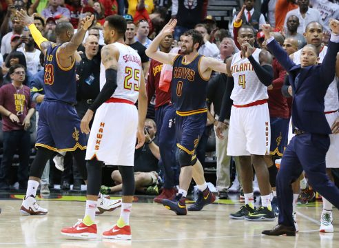 May 8, 2016 - Atlanta, GA, USA - Atlanta Hawks' Thabo Sefolosha, from left, Paul Millsap and Al Horford react as Cleveland Cavaliers' LeBron James, Kevin Love and head coach Tyronn Lue celebrate a 100-99 victory to sweep the series on Sunday, May 8, 2016, at Philips Arena in Atlanta. (Credit Image: � Curtis Compton/TNS via ZUMA Wire)