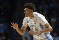 March 17, 2017 - Greenville, SC, USA - North Carolina's Justin Jackson (44) signals a 3-pointer after hitting one against Texas Southern in the first half during the first round of the NCAA Tournament on Friday, March 17, 2017, at the Bon Secours Wellness Arena in Greenville, S.C. UNC advanced, 103-64. (Credit Image: � Chuck Liddy/TNS via ZUMA Wire)