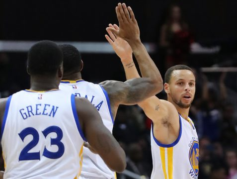 March 6, 2017 - Atlanta, GA, USA - Golden State Warriors' Stephen Curry gets five from Andre Iguodala after hitting a three-pointer against the Atlanta Hawks during the second half on Monday, March 6, 2017 in Atlanta, Ga. The Warriors beat the Hawks, 119-111. (Credit Image: � Curtis Compton/TNS via ZUMA Wire)