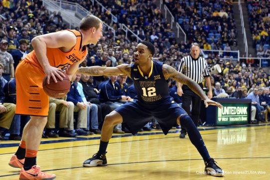 March 7, 2015 - Morgantown, WV, US - West Virginia Mountaineers guard TARIK PHILLIP (12) applies pressure on defense in the backcourt against Oklahoma State Cowboys guard PHIL FORTE III (13) during the basketball game between the Oklahoma State Cowboys and West Virginia Mountaineers played at the Coliseum in Morgantown, WV. (Credit Image: © Ken Inness/ZUMA Wire)