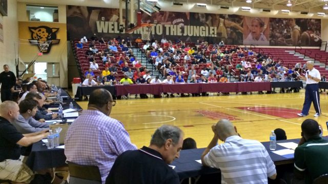 Kevin Eastman speaks to an audience at a COACHING U Live clinic.