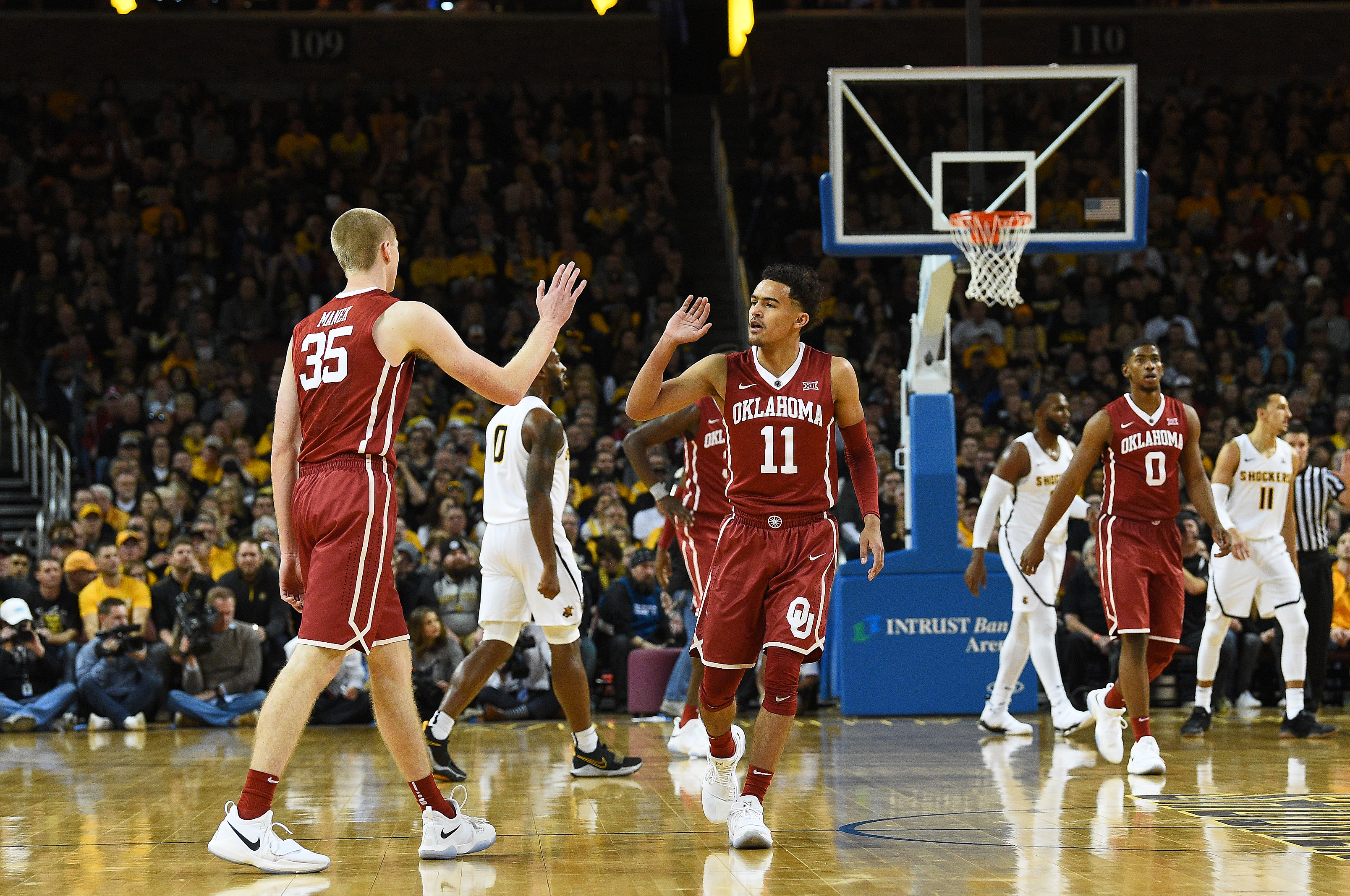 December 16, 2017: Oklahoma Sooners guard Trae Young (11) high fives Oklahoma Sooners forward Brady Manek (35) as the teams head for a timeout during the NCAA Basketball Game between the Oklahoma Sooners and the Wichita State Shockers at Intrust Bank Arena in Wichita,Kansas. Kendall Shaw/CSM(Credit Image: © Kendall Shaw/CSM via ZUMA Wire)