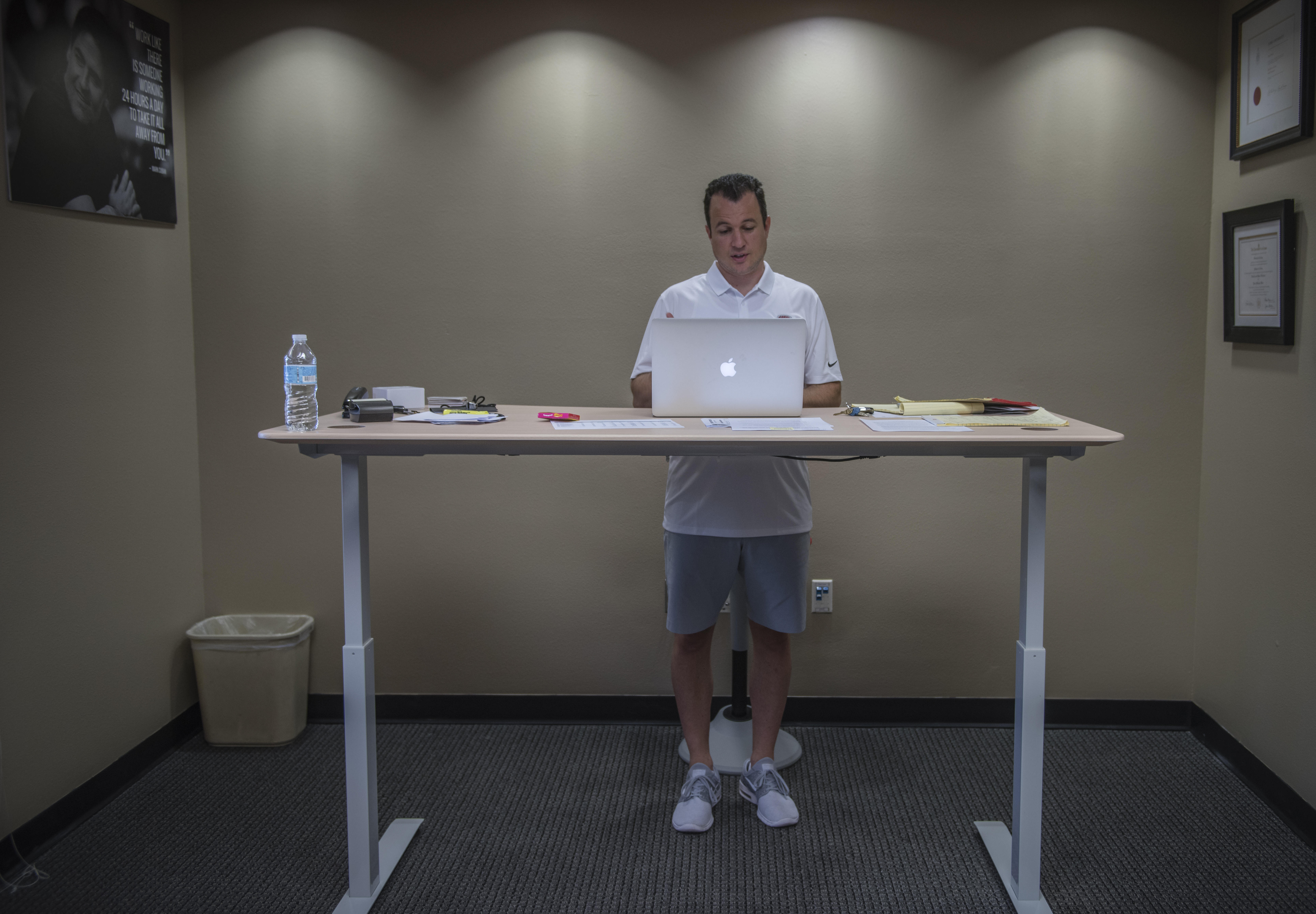 July 26, 2017 - Albuquerque, NM, U.S. - Albuquerque Journal.Pictured is New Mexico's mens basketball coach Paul Weir(cq) inside his office at working at a stand up desk. photographed inside the film room at the Rudy Davalos basketball practice facility. .Albuquerque, New Mexico Roberto E. Rosales/Albuquerque Journal (Credit Image: © Roberto E. Rosales/Albuquerque Journal via ZUMA Wire)