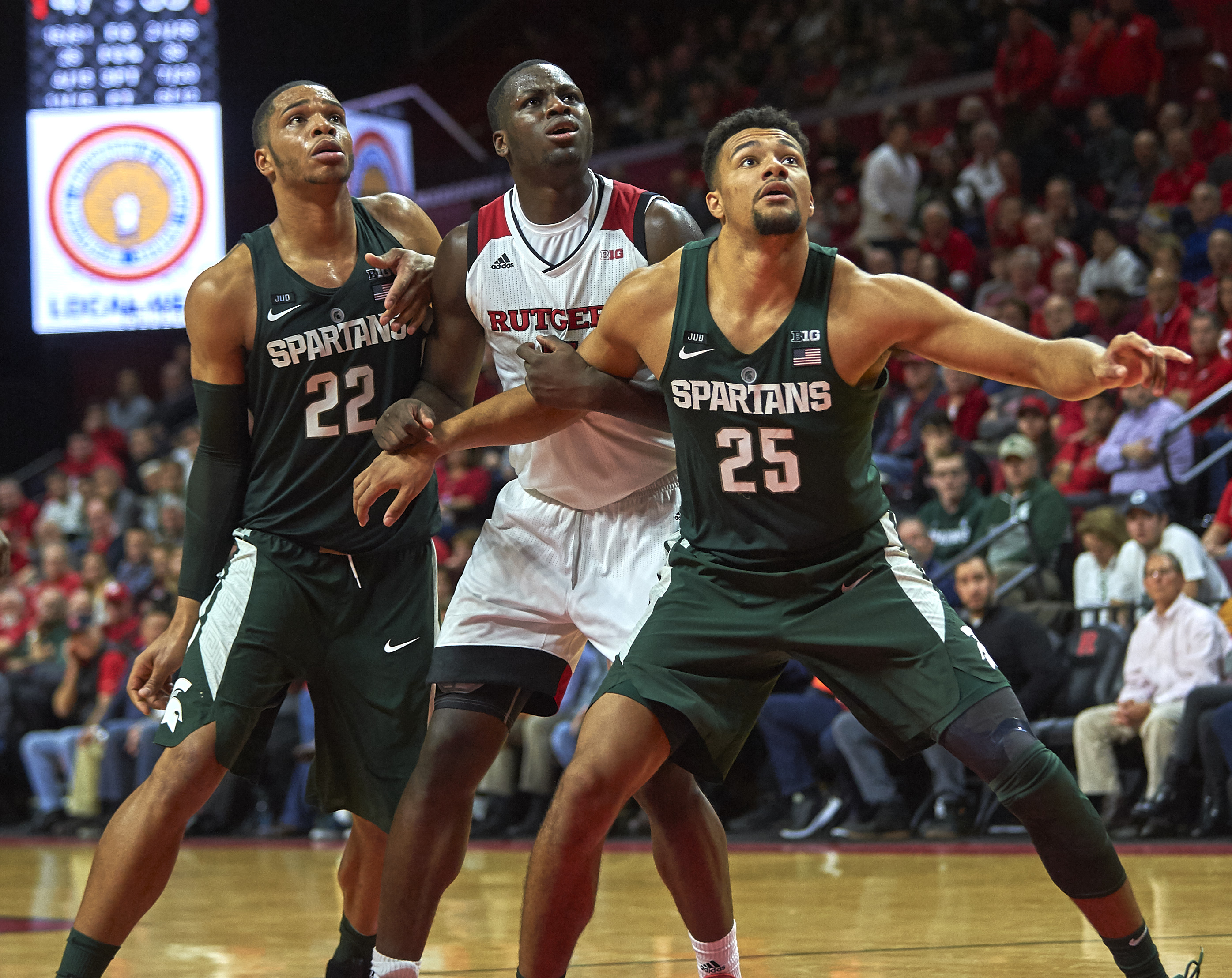 December 6, 2017 - Piscataway, New Jersey, U.S. - Michigan State's forward Kenny Goins (25) blocks out Rutgers forward Eugene Omoruyi (11) in the second half during NCAA basketball action between the Michigan State Spartans and the Rutgers Scarlet Knights at Rutgers Athletic Center in Piscataway, New Jersey. Michigan State defeated Rutgers 62-52. Duncan Williams/CSM(Credit Image: © Duncan Williams/CSM via ZUMA Wire)