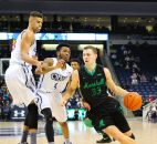 February 23, 2017 - NCAA Basketball: Marshall Thundering Herd guard Jon Elmore (33) dribbles around Old Dominion Monarchs guard Ahmad Caver (4) and Old Dominion Monarchs forward Trey Porter (15) during the Marshall Thundering Herd vs Old Dominion Monarchs game at Ted Constant Center in Norfolk, VA. Old Dominion beat Marshall 86-65. Jen Hadsell/CSM(Credit Image: © Jen Hadsell/CSM via ZUMA Wire)