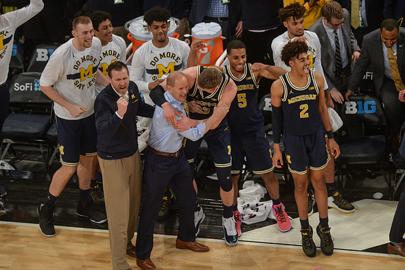 March 4, 2018 - New York, New York, U.S - Michigan Head Coach JOHN BEILEIN and MORITZ WAGNER (13) celebrate at the end of the game held at Madison Square Gardens in New York, New York. (Credit Image: © Amy Sanderson via ZUMA Wire)
