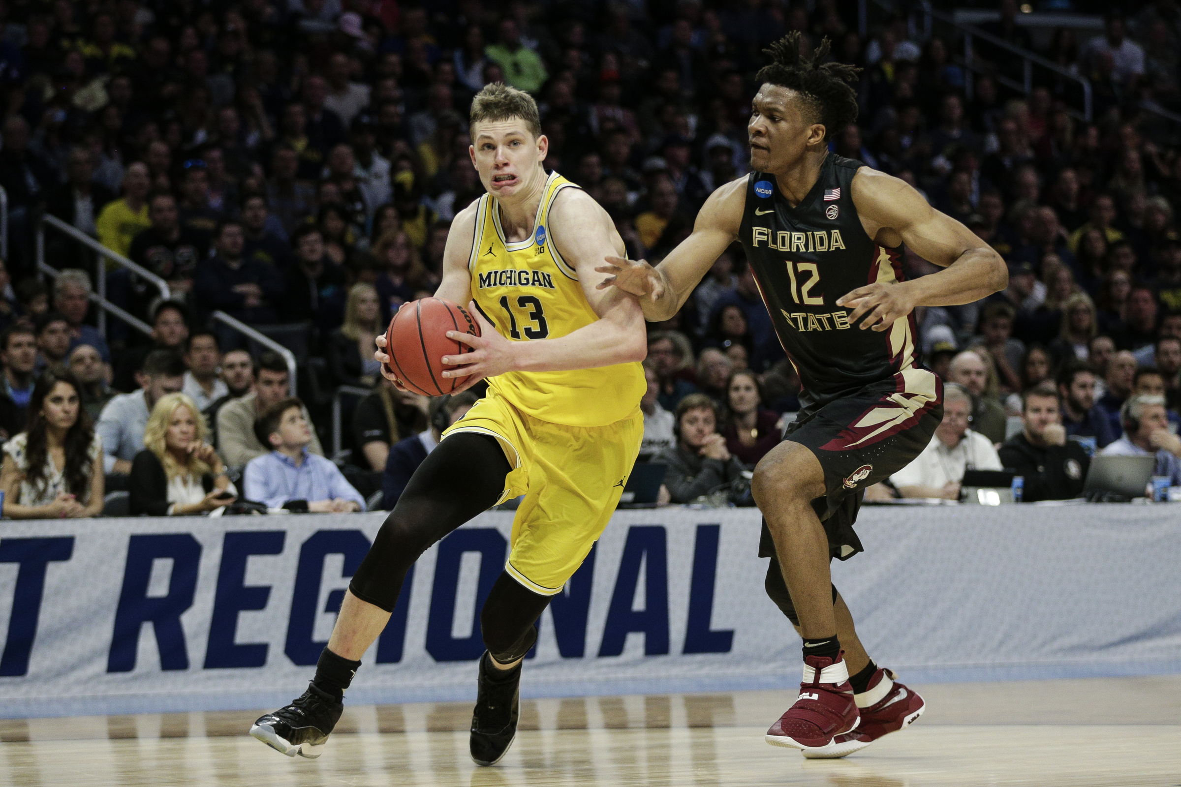March 24, 2018 - Los Angeles, CA, USA - Michigan's Moritz Wagner (13) drives against Florida State's Ike Obiagu (12)during the first half of an NCAA Tournament regional final at Staples Center in Los Angeles on Saturday, March 24, 2018. (Credit Image: © Junfu Han/TNS via ZUMA Wire)