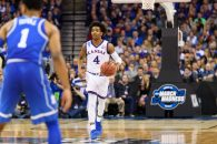 March 25, 2018 - Omaha, NE U.S. - Kansas Jayhawks guard Devonte' Graham #4 in action during the Elite 8, Midwest Regional, NCAA men's basketball game between #2 Duke Blue Devils and #1 Kansas Jayhawks at the CenturyLink Center in Omaha, NE..Attendance:17579.Kansas Won 85-81 OT.Jimmy Rash/Cal Sport Media(Credit Image: © Jimmy Rash/CSM via ZUMA Wire)