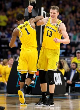 March 31, 2018 - San Antonio, TX, USA - Michigan's Moritz Wagner (13) and Charles Matthews (1) celebrate amid a 69-57 victory against Loyola during an NCAA Tournament national semifinal at the Alamodome in San Antonio, Texas, on Saturday, March 31, 2018. (Credit Image: © Kirthmon F. Dozier/TNS via ZUMA Wire)