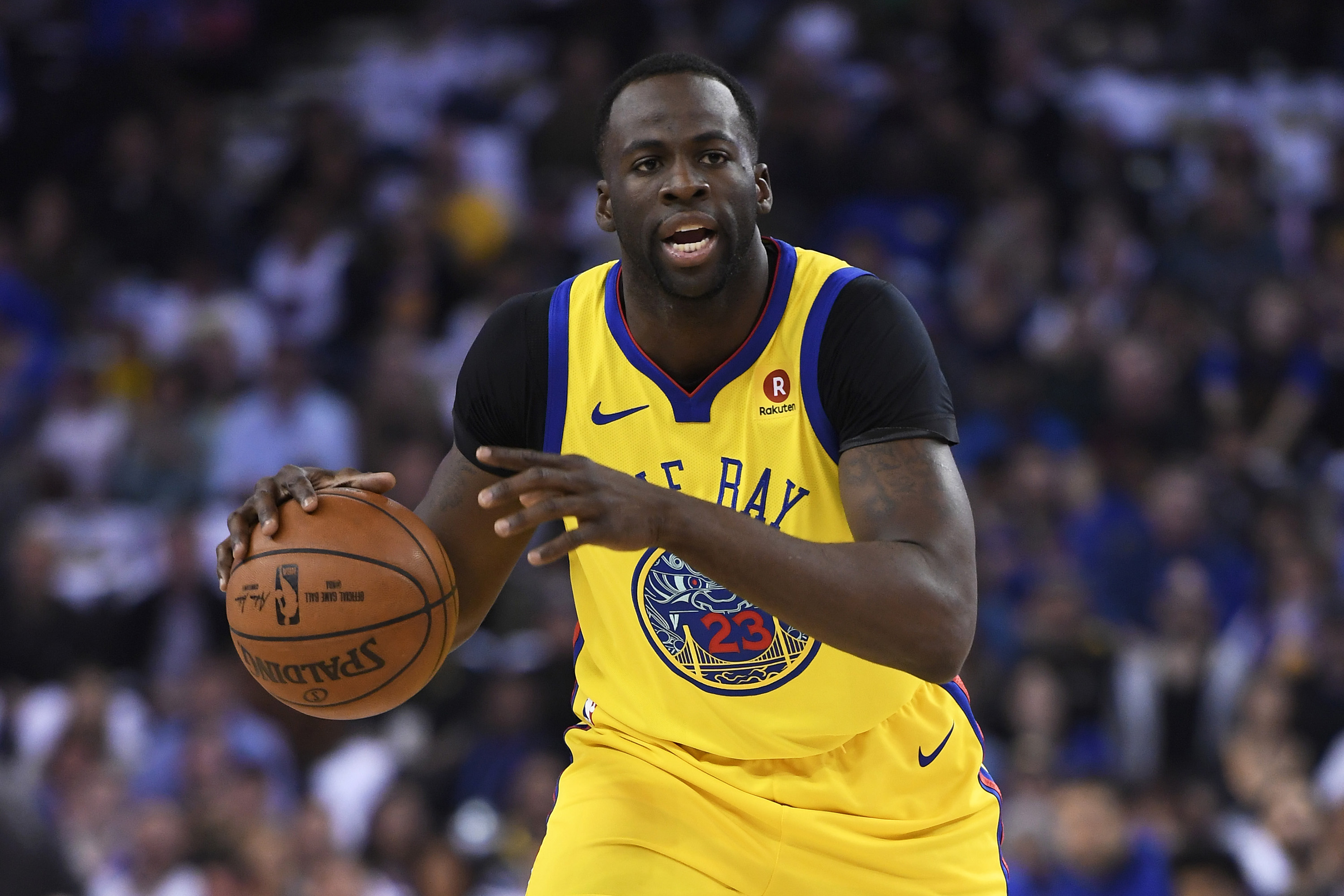 March 8, 2018 - Oakland, CA, USA - In a March 8, 2018, file image, the Golden State Warriors' Draymond Green looks to pass against the San Antonio Spurs at the Oracle Arena in Oakland, Calif. On Saturday, March 17, 2018, in Phoenix, Green scored 25 points with 11 rebounds in a 124-109 win against the Suns. (Credit Image: © Jose Carlos Fajardo/TNS via ZUMA Wire)