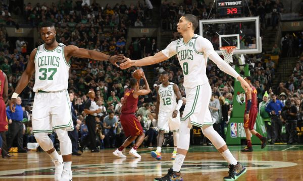 BOSTON, MA - MAY 13: Semi Ojeleye #37 and Jayson Tatum #0 of the Boston Celtics high five in Game One of the Eastern Conference Finals against the Cleveland Cavaliers during the 2018 NBA Playoffs on May 13, 2018 at the TD Garden in Boston, Massachusetts.  NOTE TO USER: User expressly acknowledges and agrees that, by downloading and or using this photograph, User is consenting to the terms and conditions of the Getty Images License Agreement. Mandatory Copyright Notice: Copyright 2018 NBAE  (Photo by Brian Babineau/NBAE via Getty Images)