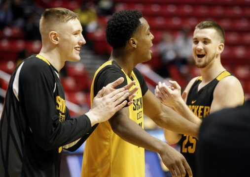 March 15, 2018 - San Diego, CA, USA - SAN DIEGO, March 15, 2018 | Wichita State's Darral Willis Jr., center, Brett Barney, right, and Rauno Nurger share a laugh during Wichita State's practice for the NCAA tournament at the Viejas Arena in San Diego on Thursday. | Photo by Hayne Palmour IV/San Diego Union-Tribune/Mandatory Credit: HAYNE PALMOUR IV/SAN DIEGO UNION-TRIBUNE/ZUMA PRESS San Diego Union-Tribune Photo by Hayne Palmour IV copyright 2017 (Credit Image: © Hayne Palmour Iv/San Diego Union-Tribune via ZUMA Wire)