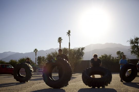 Apr. 4, 2011 - Palm Springs, CA, U.S. - Kids warm up in 100-degree weather before a youth boxing tournament by flipping tires through a parking lot Monday, Mar. 28, 2011, at the Palm Springs Boxing Club in Palm Springs, CA. (Credit Image: © Jordan Stead/ZUMAPRESS.com)