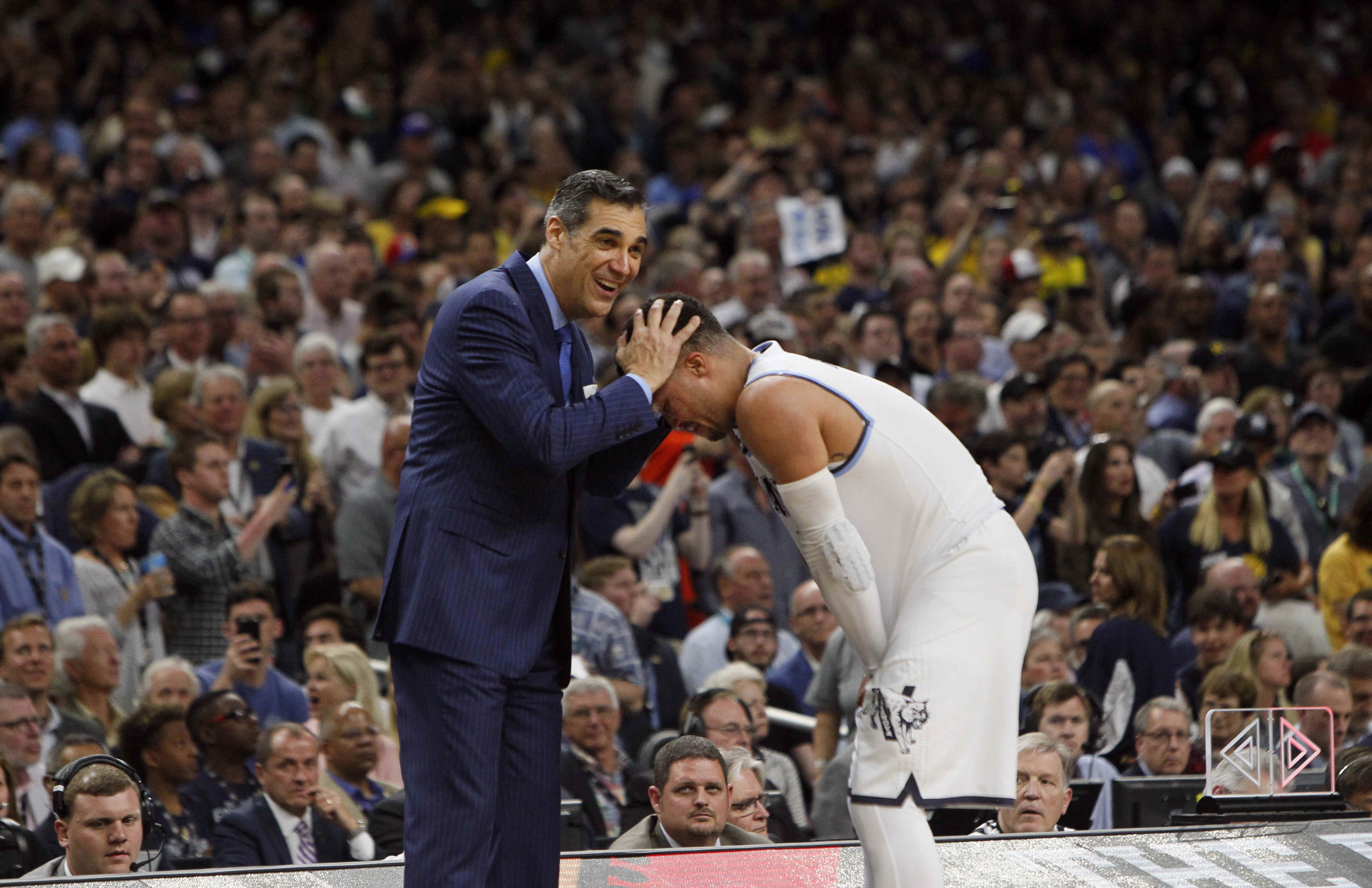 SAN ANTONIO, April 3, 2018  Jay Wright (L), head coach of Villanova, hugs player Jalen Brunson during the championship game against Michigan of the Final Four NCAA college basketball tournament,in San Antonio, Texas, the United States, on April 2, 2018. Villanova claimed the title by defeating Michigan with 79-62.  wll) (Credit Image: © Song Qiong/Xinhua via ZUMA Wire)