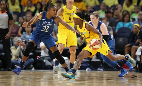 July 18, 2018 - Minneapolis, MN, USA - Minnesota Lynx's Rebekkah Brunson plays defense on Indiana Fever's Erica Wheeler on Wednesday, July 18, 2018 at Target Center in Minneapolis, Minn. The Minnesota Lynx beat the Indiana Fever, 89-65. (Credit Image: © Jerry Holt/TNS via ZUMA Wire)