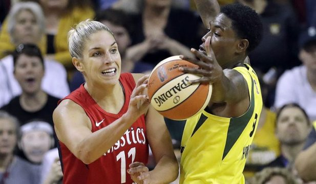 Seattle Storm's Natasha Howard, right, deflects a pass by Washington Mystics' Elena Delle Donne in the second half of Game 2 of the WNBA basketball finals Sunday, Sept. 9, 2018, in Seattle. The Storm won 75-73. (AP Photo/Elaine Thompson)