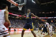 March 9, 2018 - Kansas City, MO, U.S. - KANSAS Kansas City, MO - MARCH 09: West Virginia Mountaineers forward Lamont West (15) pressures the inbounds pass of Texas Tech Red Raiders guard Zhaire Smith (2) in the second half of a semifinal game in the Big 12 Basketball Championship between the West Virginia Mountaineers and Texas Tech Red Raiders on March 9, 2018 at Sprint Center in Kansas City, MO.  West Virginia won 66-63. (Photo by Scott Winters/Icon Sportswire) (Credit Image: © Scott Winters/Icon SMI via ZUMA Press)