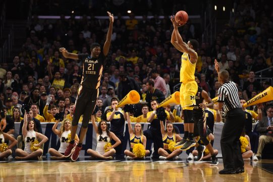 March 24, 2018 - Los Angeles, CA, U.S. - LOS ANGELES, CA - MARCH 24: G Charles Matthews (1) of the Michigan Wolverines shoots a three pointer over C Chris Koumadje (21) of the Florida State Seminoles during the NCAA Division I Men's Championship Elite Eight round basketball game between the Florida State Seminoles and the Michigan Wolverines on March 24, 2018 at STAPLES Center in Los Angeles, CA. (Photo by Chris Williams/Icon Sportswire) (Credit Image: © Chris Williams/Icon SMI via ZUMA Press)