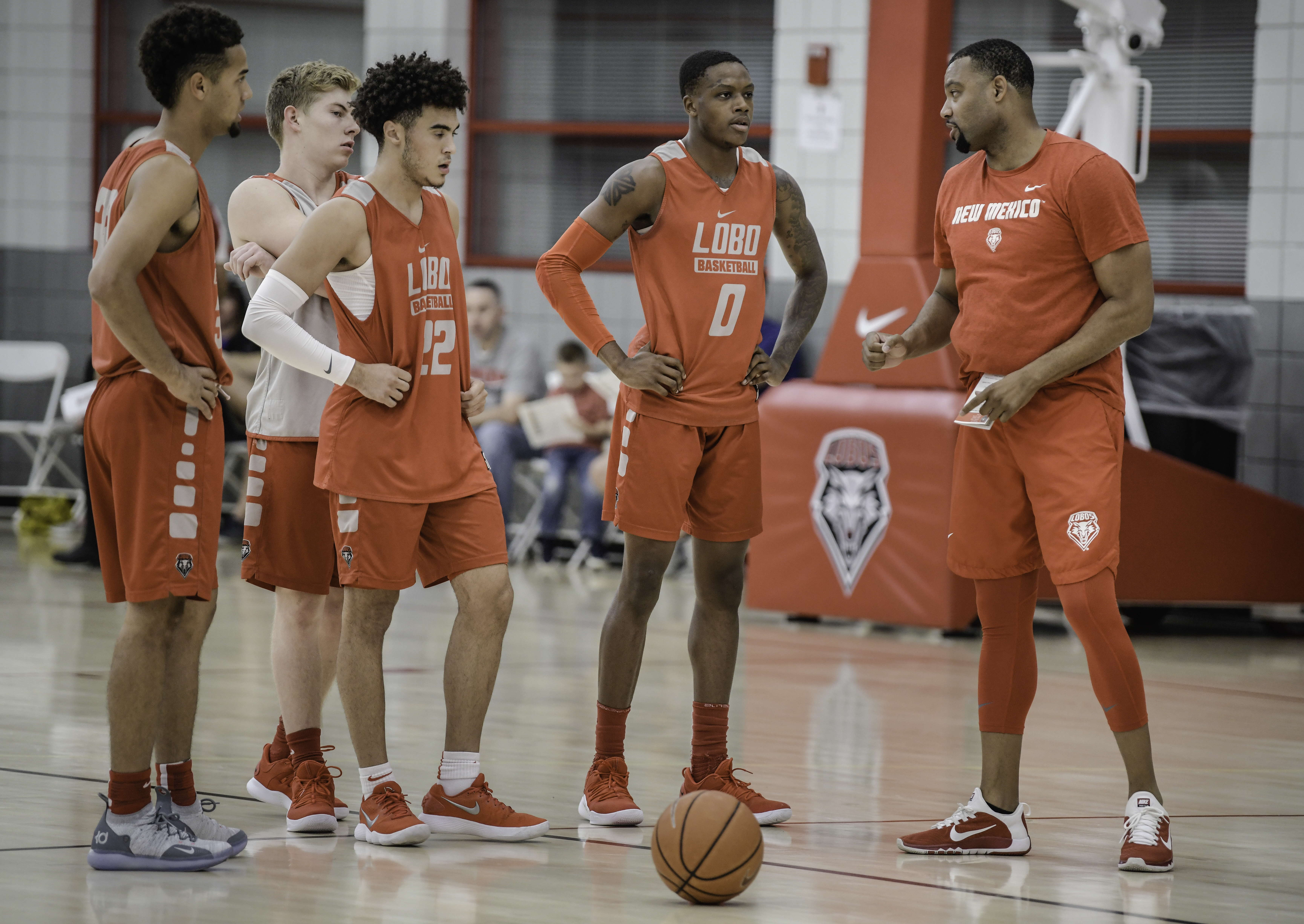 September 28, 2018 - Albuquerque, New Mexico, U.S. - Roberto E. RosalesJournal.The UNM Lobos basketball team held their first practice Friday afternoon with several newcomers joining the team.  Pictured from left to right are Anthony Mathis(Cq), Clay Patterson(Cq) Drue Drinnon(Cq)Keith McGee(Cq) as they listen to assistant coach Brandon Mason(Cq) on the far right. .Albuquerque, New Mexico  (Credit Image: © Roberto E. Rosales/Albuquerque Journal via ZUMA Wire)