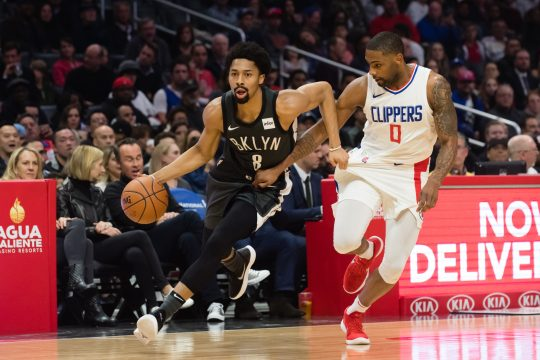 March 4, 2018 - Los Angeles, CA, U.S. - LOS ANGELES, CA - MARCH 04: Brooklyn Nets Guard Spencer Dinwiddie (8) and Los Angeles Clippers Guard Sindarius Thornwell (0) grab each others jerseys as they go down the court during the game between the Brooklyn Nets and the L.A. Clippers on March 04, 2018, at STAPLES Center in Los Angeles, CA. (Photo by David Dennis/Icon Sportswire) (Credit Image: © David Dennis/Icon SMI via ZUMA Press)