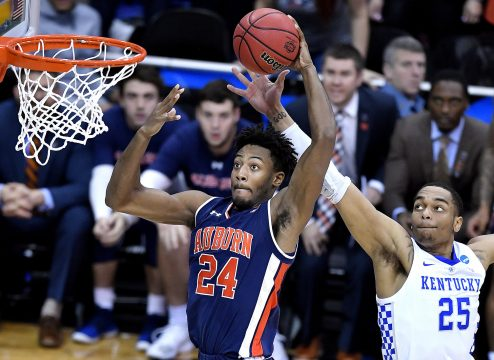 March 31, 2019 - Kansas City, Missouri, U.S. - Auburn Tigers' ANFERNEE MCLEMORE sails past Kentucky Wildcats' PJ WASHINGTON for a shot during the second half of the NCAA Midwest Regional Final. Auburn beat Kentucky, 77-71, in overtime, to earn their first trip to the Final Four. (Credit Image: © Rich Sugg/Kansas City Star/TNS via ZUMA Wire)