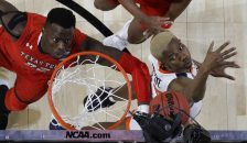 Texas Tech's Norense Odiase, left, and Virginia's Mamadi Diakite battle for a rebound during the first half in the championship of the Final Four NCAA college basketball tournament, Monday, April 8, 2019, in Minneapolis. (AP Photo/David J. Phillip)