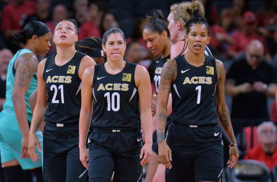 LAS VEGAS, NV - AUGUST 15:  Kayla McBride #21, Kelsey Plum #10 and Tamera Young #1 of the Las Vegas Aces stand on the court during their game against the New York Liberty at the Mandalay Bay Events Center on August 15, 2018 in Las Vegas, Nevada. NOTE TO USER: User expressly acknowledges and agrees that, by downloading and or using this photograph, User is consenting to the terms and conditions of the Getty Images License Agreement.  (Photo by Sam Wasson/Getty Images)