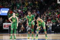March 31, 2019: The Oregon Ducks backcourt of Oregon Ducks guard Sabrina Ionescu (20), Oregon Ducks forward Ruthy Hebard (24), and Oregon Ducks forward Satou Sabally (0) watch a free throw during the NCAA Women's Championship Elite 8 game between the Oregon Ducks and the Mississippi State Bulldogs at the Moda Center, Portland, Oregon. Larry C. Lawson/CSM(Credit Image: © Larry C. Lawson/CSM via ZUMA Wire)