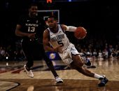 March 15, 2019 - New York, New York, U.S. - Villanova Wildcats guard Phil Booth (5) drives to the basket n the first half during semifinal round of the Big East Tournament between the Xavier Musketeers and the Villanova Wildcats at Madison Square Garden in New York City. Duncan Williams/CSM(Credit Image: © Duncan Williams/CSM via ZUMA Wire)