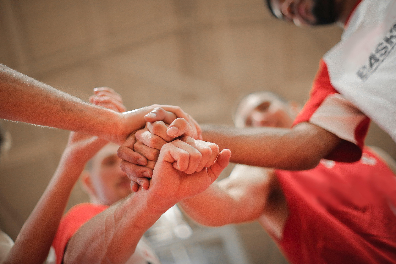 basketball-team-stacking-hands-together-3755440